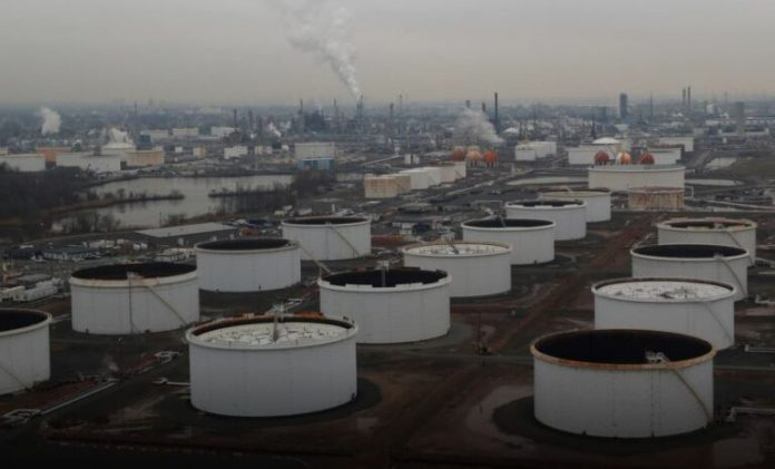 Oil prices edge up on strong China data, U.S. crude oil draw