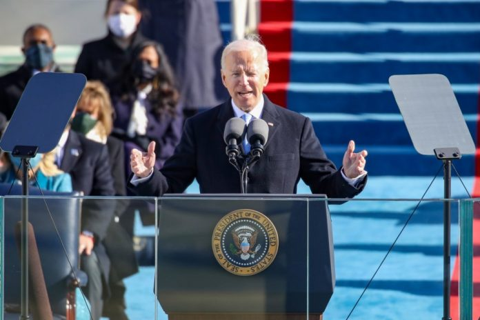 Biden urges U.S. Congress to approve police reform in May