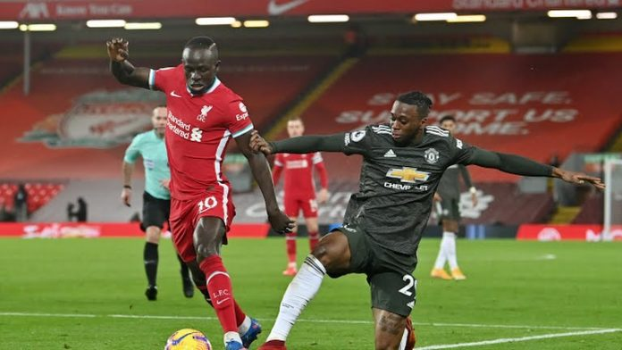 Manchester United maintain leadership after goalless draw at Liverpool